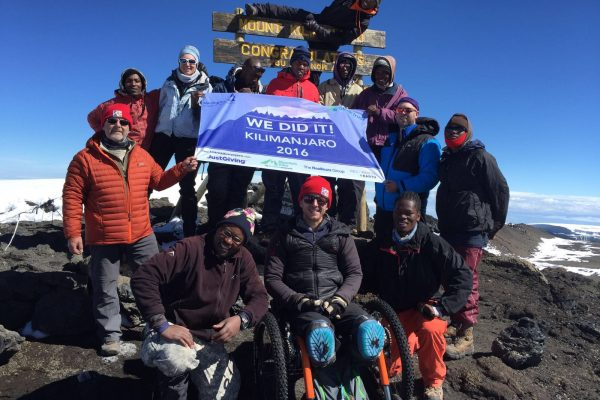 Aaron Phipps makes it to the summit of Mt Kilimanjaro with all terrain Mountain Trike wheelchair